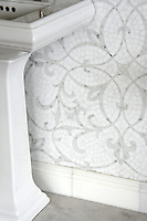 Marabel, a hand cut natural stone mosaic, is shown in honed Thassos and polished Calacatta Tia.
