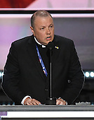 Monsignor Kieran Harrington of the Catholic Diocese of Brooklyn, New York delivers the invocation opening the evening session of the 2016 Republican National Convention held at the Quicken Loans Arena in Cleveland, Ohio on Monday, July 18, 2016.<br /> Credit: Ron Sachs / CNP<br /> (RESTRICTION: NO New York or New Jersey Newspapers or newspapers within a 75 mile radius of New York City)