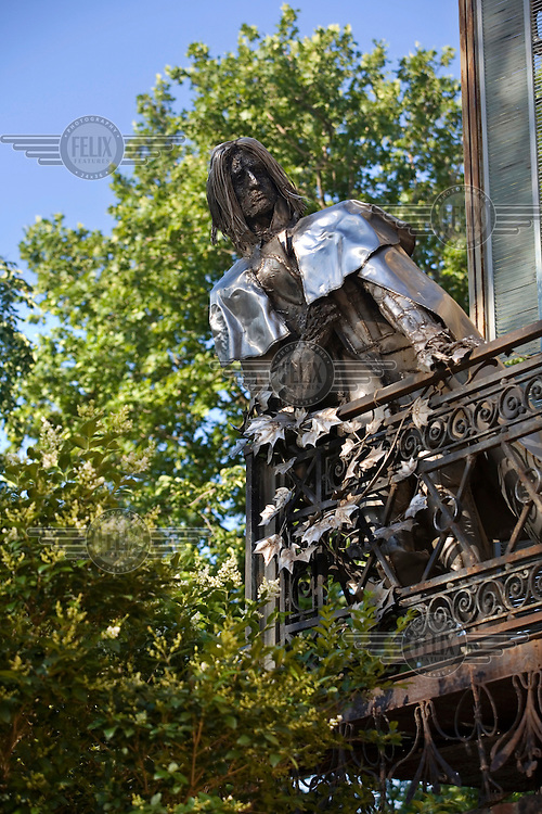 A statue of the composer Franz Liszt (by sculptor Imre Varga, 1983) peers over the balcony of the Bishop's Palace.