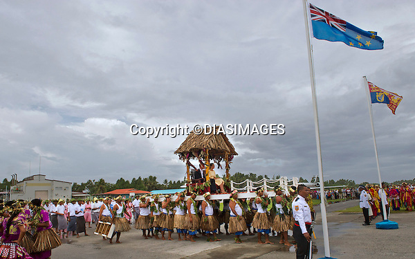 """CATHERINE, DUCHESS OF CAMBRIDGE AND PRINCE WILLIAM.seated in chairs are carried on the shoulders of local men and women on arrival at Funafuti, Tuvalu_18/09/2012.Mandatory credit photo: ©DIASIMAGES/NEWSPIX INTERNATIONAL..(Failure to credit will incur a surcharge of 100% of reproduction fees)..                **ALL FEES PAYABLE TO: """"NEWSPIX INTERNATIONAL""""**..IMMEDIATE CONFIRMATION OF USAGE REQUIRED:.DiasImages, 31a Chinnery Hill, Bishop's Stortford, ENGLAND CM23 3PS.Tel:+441279 324672  ; Fax: +441279656877.Mobile:  07775681153.e-mail: info@newspixinternational.co.uk"""