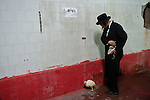 An Ultra-Orthodox Jewish man and a chicken during a 'Kaparot' ceremony, in the ultra-orthodox Jewish city of Bnei Brak, near Tel Aviv, Israel. The participants in the Jewish ritual believe they transfer their past year's sins to the chicken, and perform it before the Day of Atonement ('Yom Kippur'), the holiest day in the Jewish calendar.