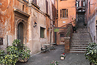 Charming small courtyard with staircase to old stuccoed buildings, Rome, Italy. Picture by Manuel Cohen