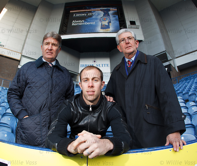 Sandy Jardine, Steven Whittaker and stairway 13 survivor Ian Loch at Ibrox Stadium beneath a banner memorial to the 66 dead. Stairway 13 decended from where the banner is currently placed over the giant TV screen