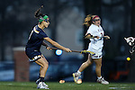 23 February 2017: Notre Dame's Nikki Ortega (left) takes a shot. The Elon University Phoenix hosted the University of Notre Dame Fighting Irish at Rudd Field in Elon, North Carolina in a 2017 Division I College Women's Lacrosse match. Notre Dame won the game 16-7.