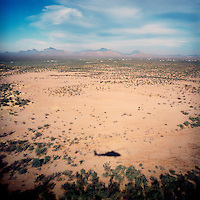 Border patrol blackhawk patrols the desert near the US-Mexico Border.Arizona.12/0/05..photo: Hector Emanuel.