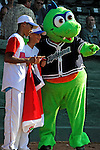 """2 July 2011: Members of a visiting Dominican Republic youth Team stand with mascot """"Champ"""" prior to a game between the Vermont Lake Monsters and the Tri-City ValleyCats at Centennial Field in Burlington, Vermont. The Lake Monsters rallied from a 4-2 deficit to defeat the ValletCats 7-4 in NY Penn League action. Mandatory Credit: Ed Wolfstein Photo"""