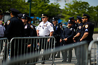 NEW YORK, NY - May 04:  NYPD officers get instructions as activists arrive to protest near the Intrepid Sea, Air and Space Museum before President Donald Trump arrive to city on May 04, 2017. in New York. U.S. president Trump will meet Australian Prime Minister Malcolm Turnbull on the 75th anniversary of the Battle of the Coral Sea by US and Australian forces against the Japanese In New York City. Photo by VIEWpress/Eduardo MunozAlvarez