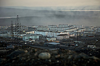Gases emitted from the nickel processing facility at Nikel in the Russian Arctic. Sulphur dioxide emitted from the factory has killed vegetation, polluted ground water and causes asthma, especially among children. The factory was built in 1937 during Stalin's rule. In 2001, Norway gave Norilsk Nickel, the head company, 32 million euros to modernise the facility and cut the pollution. The money disappeared, but the factory was not improved. /Felix Features