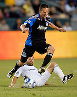 San Jose Earthquakes midfielder Sam Cronin (4) leaps over sliding LA Galaxy midfielder Dema Kovalenko (8). The LA Galaxy and the San Jose Earthquakes played to a 2-2 draw at Home Depot Center stadium in Carson, California on Thursday July 22, 2010.