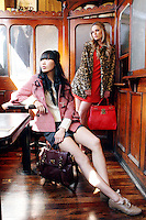 NO REPRO FEE.30/8/2010. AWEAR AUTUMN COLLECTION. Yomiko Chen & Sarah Morrissey model a selection of dresses from A|wear's new autumn '10 collection at Kehoes Pub in Dublin. Sarah wears Leopard Print Swing Coat - EUR70 Tamarind Bow Shift Dress - EUR45 - EUR35 .Yomiko Chen wears Red woven duffle coat - EUR60 Side tie shorts - EUR30 Aran knit jumper - EUR35  The collection arrives instore and onwww.awear.comfrom this week. Picture James Horan/Collins Photos