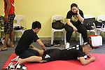Saiful Merican, 1st ranked WMA featherweight, massaged by trainer<br />