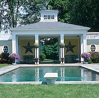 The classical swimming pool pavilion was built to compliment the house
