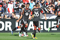 Rafael Teixeira (9) of D.C. United celebrates his score in the 22th of the game with teammate Lionard Pajoy. The Columbus Crew defeated D.C. United 2-1 ,at RFK Stadium, Saturday March 23,2013.
