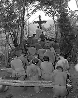Chaplain Kenny Lynch conducts services north of Hwachon, Korea, for men of 31st Regt.  August 28, 1951.  Pvt. Jack D. Johnson. (Army)<br /> NARA FILE #  111-SC-378917<br /> WAR &amp; CONFLICT BOOK #:  1463