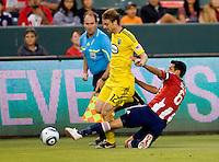 Chivas USA defender Ante Jazic (6) attempts a tackle on Columbus Crew midfielder Eddie Gaven (12). CD Chivas USA defeated the Columbus Crew 3-1 at Home Depot Center stadium in Carson, California on Saturday July 31, 2010.