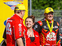 May 15, 2016; Commerce, GA, USA; NHRA top fuel driver Doug Kalitta (right) celebrates with crew chief Jim Oberhofer (left) and daughter Ashley Oberhofer after winning the Southern Nationals at Atlanta Dragway. Mandatory Credit: Mark J. Rebilas-USA TODAY Sports
