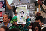 An activist holds a banner demanding justice during the dialogue with members of the National Movement for Peace with Justice and Dignity (MPJD) in the Alcazar del Castillo de Chapultepec venue in Mexico City, May 28. 2012. Sicilia and the mothers of disappeared people demanded peace to Mexico and the punishment of the authorities linked to the organized crime in Mexico. Photo by Heriberto Rodriguez