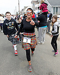SquanStrong founder Dana Connolly wearing bib #1 as she and more than 3,000 other participants start the world-record 2014 Kilt Run at the Manasquan beachfront on Sat., March, 22, 2014.