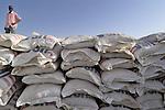 Stacks of grain await distribution to war's victims in a World Food Organization facility in Garsila, in Sudan's war-torn region of Darfur.