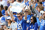 A Kentucky Wildcats fan cheers during the first half of the TaxSlayer Bowl against the Georgia Tech Yellow Jackets at EverBank Field on Saturday, December 31, 2016 in Jacksonville, Florida. Photo by Michael Reaves | Staff.