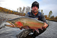 A fisherman holds a steelhead trout caught in a tributary of British Columbia's Skeena river.
