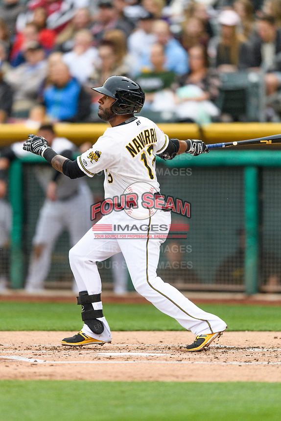 Rey Navarro (13) of the Salt Lake Bees follows through on his swing against the Sacramento River Cats during the Pacific Coast League game at Smith's Ballpark on August 11, 2017 in Salt Lake City, Utah.The River Cats defeated the Bees 8-7. (Stephen Smith/Four Seam Images)