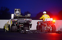 May 18, 2012; Topeka, KS, USA: A member of the NHRA safety safari pushes funny car driver Tony Pedregon off the track during qualifying for the Summer Nationals at Heartland Park Topeka. Mandatory Credit: Mark J. Rebilas-