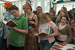 Children and adults wait in line to have their copies of Wolf Brother by signed by the author Michelle Paver. The Hay Festival, Hay on Wye, Powys, Wales, Great Britain. 2006.