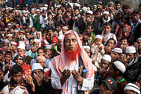 Bangladeshi Muslim men prays on the last day of World Congregation of Muslims, or Biswa Ijtema, on the banks of the River Turag just outside  Dhaka, Bangladesh. Jan 11, 2015
