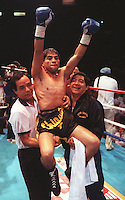 """Jul 24, 1990 - Inglewood, California, United States - Humberto """"Chiquita"""" Gonzales is carried around the ring by his corner men July 24, 1990 in Inglewood,Calif., after defeating Jung-Keun Lim of Korea in their World Boxing Council light Flyweight Title Fight. Gonzales is from Mexico. .(Credit Image: © Alan Greth)"""