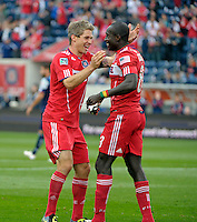 Chicago forward Dominic Oduro (8) is congratulated by teammate Logan Pause (12, left) after scoring Chicago's second goal.  The Chicago Fire defeated the New England Revolution 3-2 at Toyota Park in Bridgeview, IL on Sept. 25, 2011.