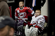 Matt Kozacko, left, and Ben Calhoun, both 8 year-old goalies, wait for their turn to play during a period break  in a Carolina Hurricanes game, January 20, 2011. The NHL All-Star Game will take place at the RBC Center Sunday, January 30th, read more on page . . .
