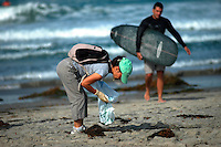 Saturday, September 20 2008.  Pacific Beach, San Diego, CA, USA:  Linh Bowman searches for trash on Pacific Beach with members of Scout Troop 295 from Clairmont.  Volunteers in the annual Coastal Cleanup found little to clean up beyond cigarette butts on San Diego's Alcohol free beaches.