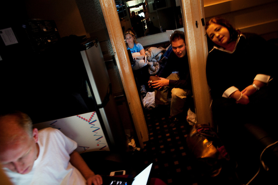"""Near Sault Sainte Marie, Michigan, April 9, 2010 - Tea Party Express staffers, from left Joe Wierzbicki, Tiffany Ruegner, Dustin Stockton and Amy Kremer on the bus en route to Sault Sainte Marie. The tour has focused on smaller towns with more conservative populations and districts they believe the incumbent can be defeated this fall. The Tea Party Express tour titled """"Just Vote Them Out"""" is taking an aggressive approach by targeting Democratic incumbents competitive districts, as well as Republicans deemed not conservative enough who are facing primary challenges from more conservative candidates.While not endorsing any candidates so far, the Tea Party Express does not hide its desire to replace incumbents with new conservatives that more closely hew to its goals of smaller government and less taxes.."""