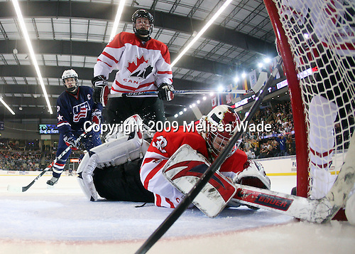 William Wrenn (US - 19), Dylan Olsen (Canada - 12), Michael Zador (Canada - 30) - The US defeated Canada 2-1 at the Urban Plains Center in Fargo, North Dakota, on Friday, April 17, 2009, in their semi-final match during the 2009 World Under 18 Championship.