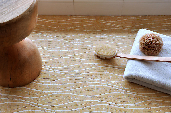 Rivulet, a hand cut stone mosaic  shown in Heavenly Cream and Jerusalem Gold, is part of the Metamorphosis Collection by Sara Baldwin for New Ravenna Mosaics.