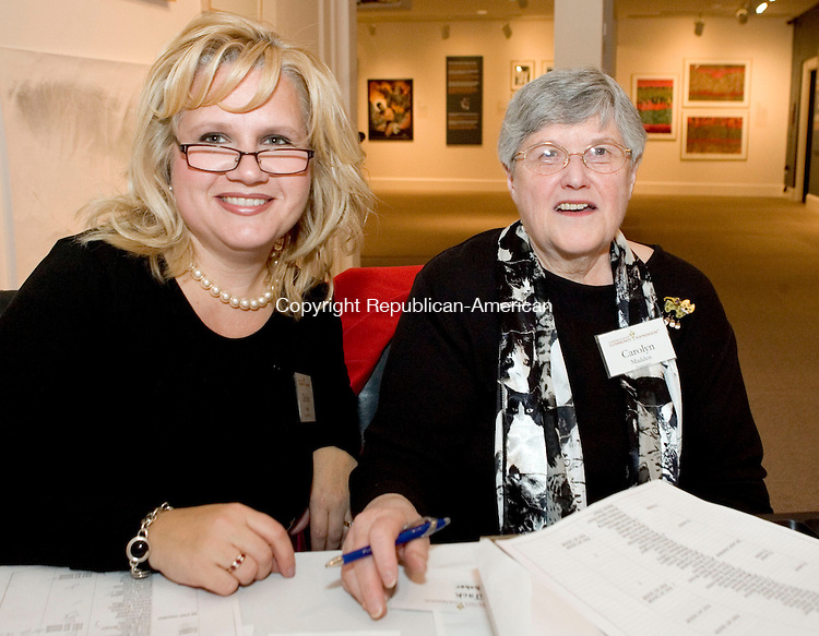 WATERBURY, CT- 23 MAY 2008- 052308JT01- <br /> Connecticut Community Foundation employees Debbie Orrino, finance officer, and Carolyn Madden, assistant, during the foundation's 85th anniversary and annual meeting event, sponsored by Webster Bank, at the Mattatuck Museum on Wednesday, May 21, 2008 in Waterbury.<br /> Josalee Thrift / Republican-American