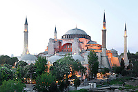 General view of Hagia Sophia, 532-37, by Isidore of Miletus and Anthemius of Tralles, Istanbul, Turkey. Hagia Sophia, The Church of the Holy Wisdom, has been a  Byzantine church and an Ottoman mosque and is now a museum. The current building, the third on the site, commissioned by Emperor Justinian I, is a very fine example of Byzantine architecture. The historical areas of the city were declared a UNESCO World Heritage Site in 1985. Picture by Manuel Cohen.