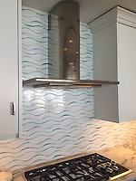 Oasis, a jewel glass waterjet mosaic shown in Moonstone and Feldspar.<br /> -photo courtesy of Julia Edelman, Buckingham Interiors and Fine Line, Chicago. Install is part of the Aqua building in Chicago.