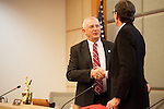 Gary Waldeck exchanges a handshake with the former mayor, Rich Larsen.