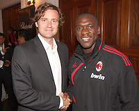 Carey Talley of DC United with Clarence Seedorf of AC Milan at a reception for AC Milan at DAR Constitution Hall in Washington DC on May 24 2010.