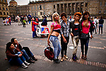 People watch prostitutes posing for a picture during a march supporting prostitution in Bolivar square in Bogota, Colombia. 25/02/2012.  Photo by Eduardo Munoz Alvarez / VIEWpress.