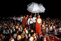 Supporters from Kyaw Min follow U Wirathu, the spiritual leader of the Buddhist nationalist 969 Movement, towards a stage to give a sermon at the Shwe Areleain Monastery in Kyaw Min Village, Myiamu Township. U Wirathu is an abbot in the New Maesoeyin Monastery where he leads about 60 monks and has influence over more than 2,500 residing there. He travels the country giving sermons to religious and laypeople encouraging Buddhists to shun Muslim business and communities. /Felix Features