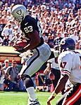Oakland Raiders vs. Chicago Bears at Oakland Alameda County Coliseum Sunday, September 26, 1999.  Raiders bet Bears  24-17.  Oakland Raiders tight end Rickey Dudley (83) make catch.