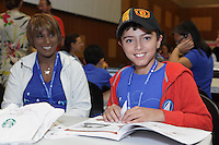 Sean Bax young origami folder in the hospitality hall at the OrigamiUSA 2014 convention with his mother, Naazneen.