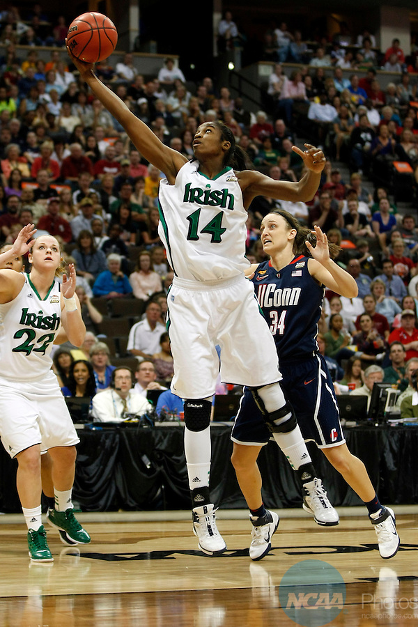 01 APRIL 2012:  Devereaux Peters (14) of the University of Notre Dame pulls down a rebound against the University of Connecticut during the Division I Women's Final Four Semifinals at the Pepsi Center in Denver, CO.  Notre Dame defeated UCONN 83-75 to advance to the national championship game.  Jamie Schwaberow/NCAA Photos