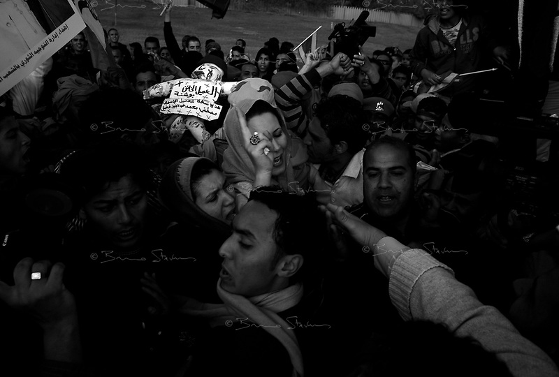 Tripoli, Libya, March 19, 2011.Aicha, Muammar Khaddafi's daughter makes an appearance amidst considerable crowd frenzy. A large crowd, about 2000 people, gather towards Bab al Azizia, Muammar Khaddafi coumpound in Tripoli to show support for the regime on the eve of the international military intervention following UN rsolution 1973.e