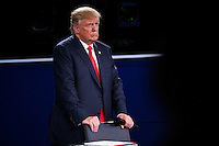 ST LOUIS, MO - OCTOBER 09: ST LOUIS, MO - OCTOBER 09: Republican presidential nominee Donald Trump (L) listens as Democratic presidential nominee former Secretary of State Hillary Clinton speaks during the town hall debate at Washington University on October 9, 2016 in St Louis, Missouri. This is the second of three presidential debates scheduled prior to the November 8th election.