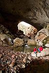 Two Figures take a break under the  massive natural bridge, Tonto, in Arizona