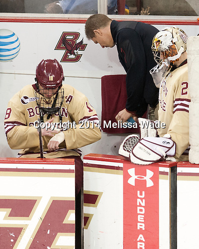 Michael Sit (BC - 18), Bert Lenz (BC - Director-Sports Medicine), Brad Barone (BC - 29) - The Boston College Eagles defeated the visiting University of Michigan Wolverines 5-1 (EN) on Saturday, December 13, 2014, at Kelley Rink in Conte Forum in Chestnut Hill, Massachusetts.